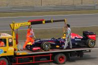 13.04.2013- Qualifying, The Red Bull Racing RB9 of Mark Webber (AUS) is recovered back to the pits o
