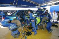 Subaru WRT mechanics work on Petter Solberg`s Impreza at the Acropolis Rally