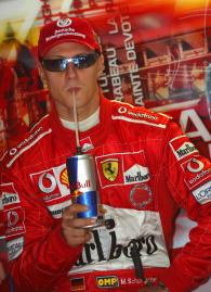 Michael Schumacher drinks from his Red Bull drinks can at the Monaco Grand Prix