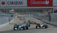 Paul Tracy gets the jump on Forsythe teammate Rodolfo Lavin at the start of the 2004 Molson Indy Van
