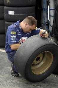 One of Rusty Wallace`s crew checks tyre pressures at New Hampshire