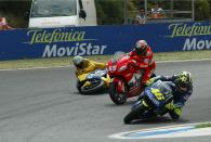 Biaggi crashes after hitting Capirossi, Portuguese MotoGP Race 2004