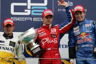 Heikki Kovalainen, Jose Maria Lopez and Scott Speed celebrate on the first-ever GP2 podium
