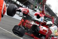 Ralf Schumacher`s Toyota TF105 is recovered after hitting the wall at the United States Grand Prix