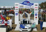 Nasser Al-Attiyah and Chris Patterson celebrate their victory in the PCWRC category on the Rally Arg