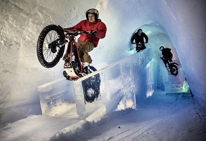Dougie Lampkin rides through ice hotel on his trials bike