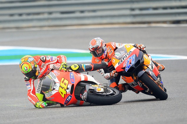 Rivals Rossi and Stoner back on track again