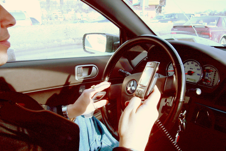Calls for 'better enforcement against drivers using mobile phones'
