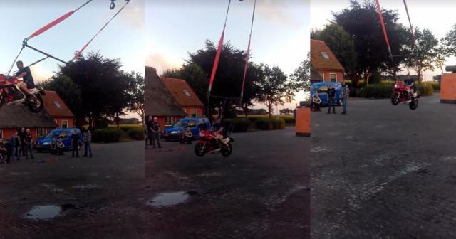 This crane-mounted motorcycle swing looks like fun