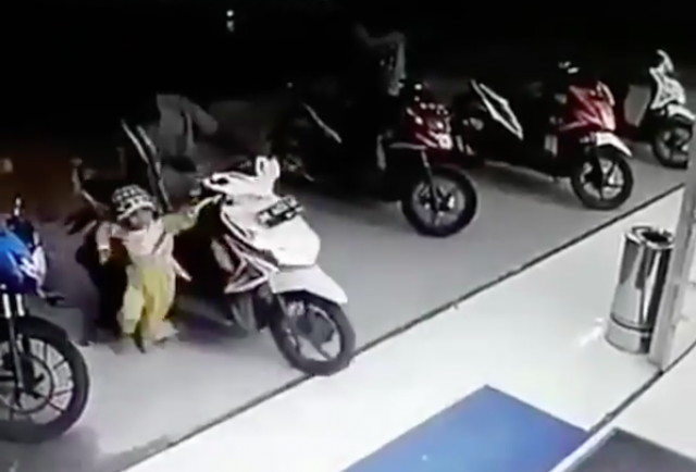Toddler twists scooter throttle, bike smashes through shop window