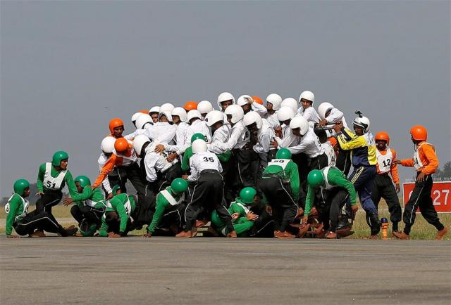 WATCH: 58 men on a single motorbike create a Guinness World Record