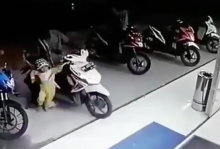 indonesia Toddler twists scooter throttle, bike smashes through shop window