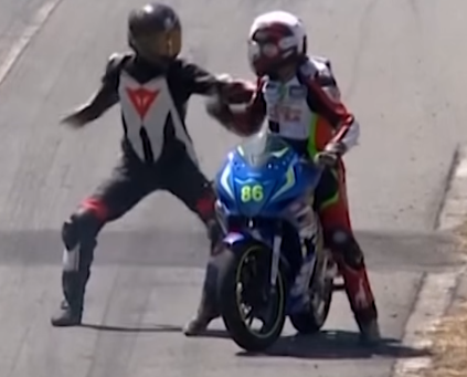 Motorcycle racer hitches a ride on his opponent