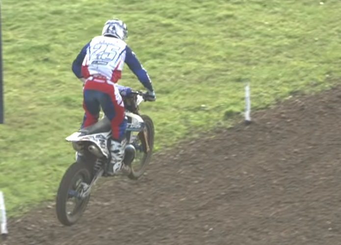 Motocross rider snaps his bike in two with a heavy landing