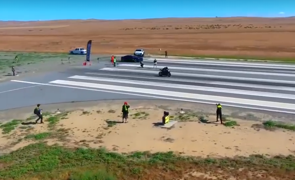 This is what happens when a car drag races a bike!