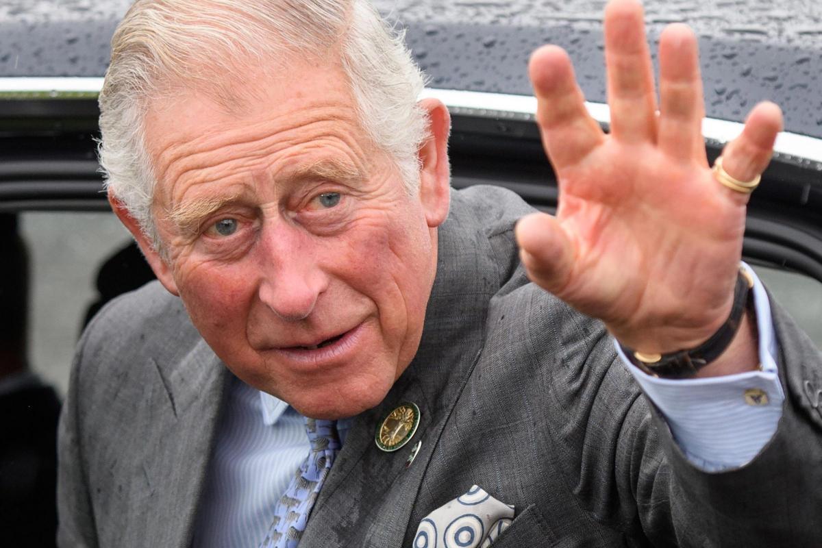 Aussie bike copscrash while escorting Prince Charles