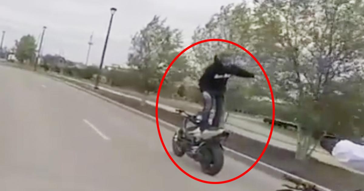 Riding a motorcycle standing up whilst facing backwards