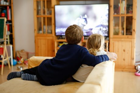 Cute Little Toddler Girl And School Kid Boy Watching Animal Movi