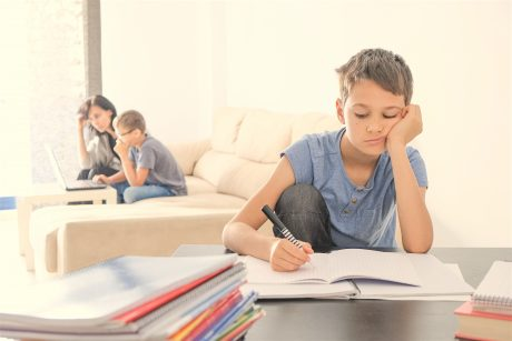 Kids Doing School Homework At Home. Mother Helping Her Teenager Son With Homework. Online Learning,