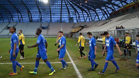 Les joueurs du GF38 au Stade des Alpes.