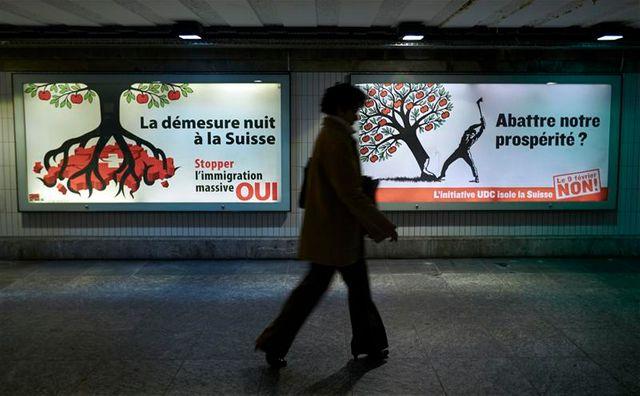 les suisses approuvent à une courte majorité les quotas d'immigration