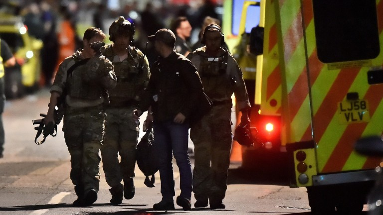 Armed officers attend to an incident near London Bridge in London, Britain, June 4, 2017. REUTERS/Hannah McKay