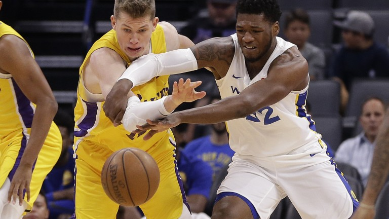 Los Angeles Lakers center Moritz Wagner, left, and Golden State Warriors forward Marcus Derrickson scramble for the ball during the first half of an NBA summer league basketball game Thursday, July 5, 2018, in Sacramento, Calif. (AP Photo/Rich Pedroncelli)