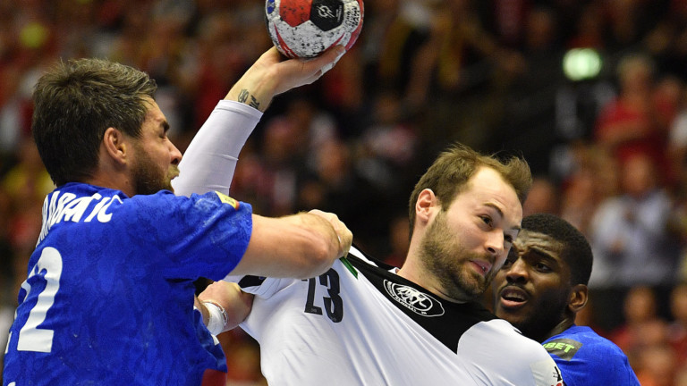 Germany's Steffen Faeth, centre, throws the ball on goal during the Handball World Championship third place match between Germany and France in Herning, Denmark, Sunday, Jan. 27, 2019. (AP Photo/Martin Meissner) |