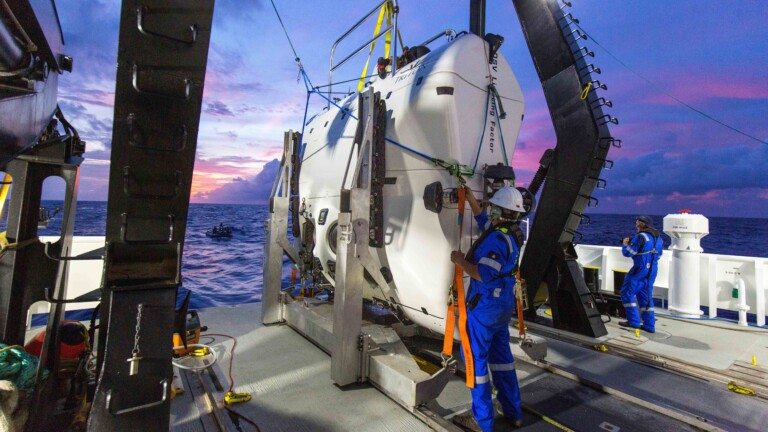 A technician checks the submarine DSV Limiting Factor aboard the research vessel DSSV Pressure Drop above the Pacific Ocean's Mariana Trench in an undated photo released by the Discovery Channel May 13, 2019.  Atlantic Productions for Discovery Channel/Tamara Stubbs/Handout via REUTERS. ATTENTION EDITORS - THIS IMAGE WAS PROVIDED BY A THIRD PARTY. NO ARCHIVE. NO RESALES. MANDATORY CREDIT.