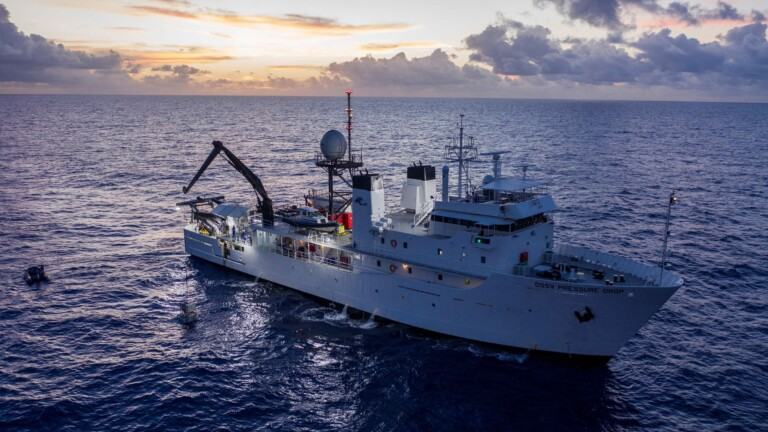 The submarine DSV Limiting Factor is tethered to a crane from the research vessel DSSV Pressure Drop above the Pacific Ocean's Mariana Trench in an undated photo released by the Discovery Channel May 13, 2019. Atlantic Productions for Discovery Channel/Tamara Stubbs/Handout via REUTERS. ATTENTION EDITORS - THIS IMAGE WAS PROVIDED BY A THIRD PARTY. NO ARCHIVE. NO RESALES. MANDATORY CREDIT.