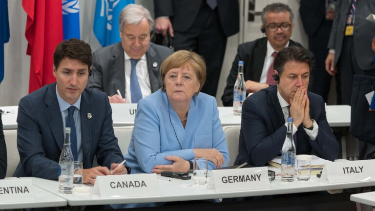 Justin Trudeau, Angela Merkel and Giuseppe Conte during a meeting on world economy at the first day of the G20 Summit in Osaka, Japan on June 28, 2019. Photo by Jacques Witt/Pool/ABACAPRESS.COM |