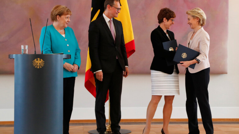 Outgoing German defence Minister Ursula von der Leyen and incoming German defence Minister Annegret Kramp-Karrenbauer shake hands after receiving certificates from Berlin mayor Michael Mueller, deputising German President Frank-Walter Steinmeier, during a ceremony at Bellevue Palace in Berlin, Germany, July 17, 2019. REUTERS/Fabrizio Bensch