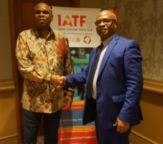 Afreximbank President Prof. Benedict Oramah (right) in handshake with Dr. Yani Younoussa, Governor of the Central Bank of Comoros, after the meeting in Bali, Indonesia.