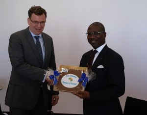 Afreximbank President Jean-Louis Ekra (right) receives souvenir from Dr. Thomas Duve, Director, Southern Africa/Regional Funds of KfW