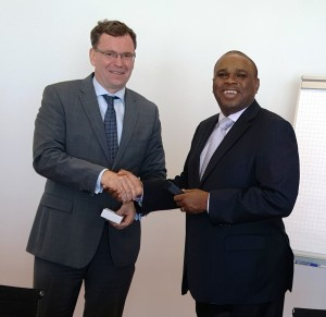 Afreximbank President Designate Dr. Benedict Oramah (right) shakes hands with Dr. Thomas Duve, Director, Southern Africa/Regional Funds of KfW Africa after receiving a souvenir.
