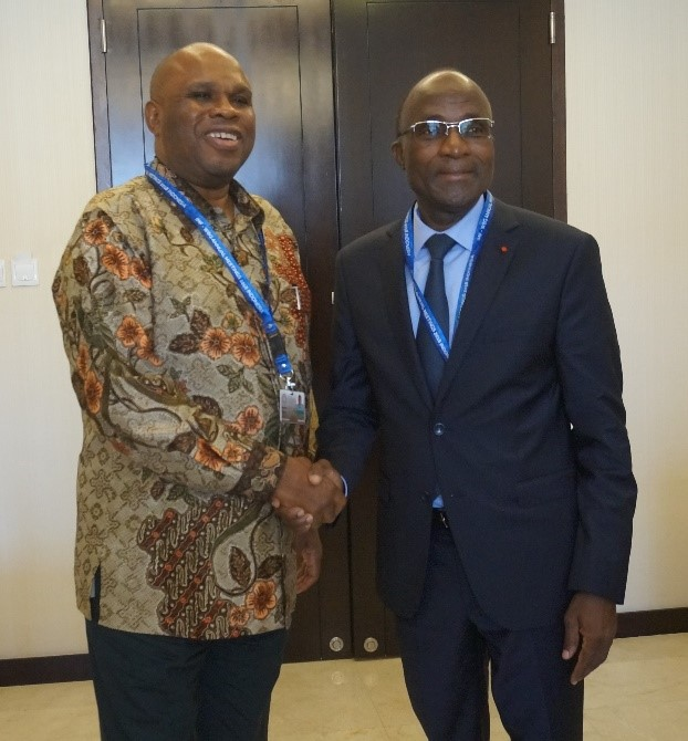 Afreximbank President Prof. Benedict Oramah (left) with Adama Kone, Minister of Economy Finance of Cote d'Ivoire, after the meeting in Bali, Indonesia.