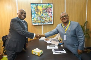 Afreximbank President Dr. Benedict Oramah (left) in handshake with Milton Weeks, Governor of the Central Bank of Liberia.