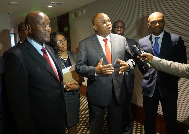 Afreximbank President Dr. Benedict Oramah answers reporters' questions after his meeting with Vice President Daniel Kablan Duncan of Cote d'Ivoire in Ahmedabad, India. With him (L-R): Vice President Duncan; Kanayo Awani, Managing Director, Intra-African Trade Initiative, Afreximbank; an Ivorian official; and Jean-Christian Koudou of Afreximbank's Export Development Finance Department.