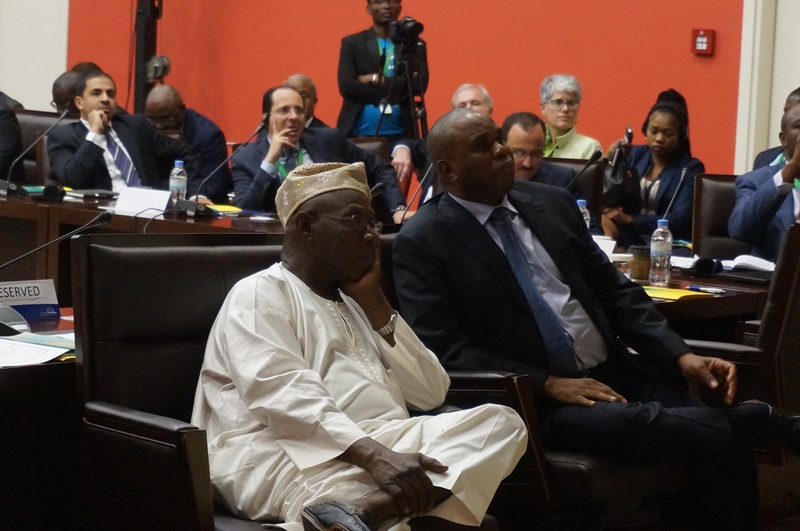 Former Nigerian President Olusegun Obasanjo ((left) and Afreximbank President Dr. Benedict Oramah listen to a presentation during the first Roundtable of the Intra-Champs in Kigali.