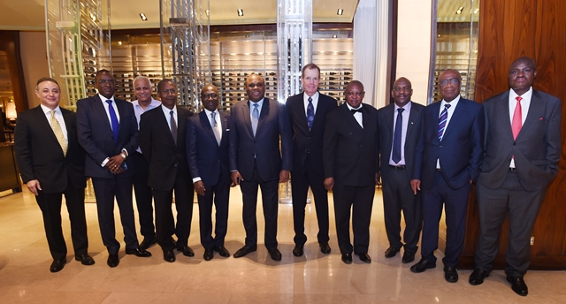 Mr. Kennedy (5th right) in group photo with current and former Afreximbank Presidents, Board Members, members of the Bank Management and other guests.