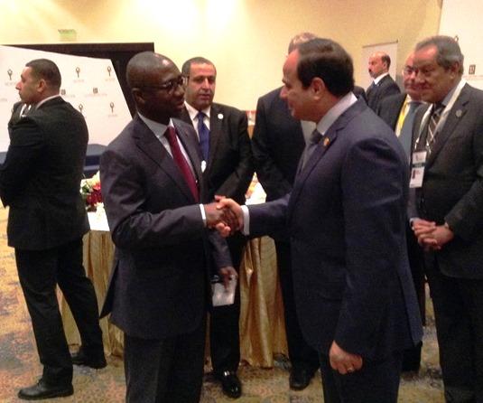 Afreximbank President Jean-Louis Ekra (left) in handshake with President Abdel Fattah Al-Sisi of Egypt.