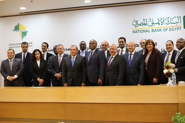 The Afreximbank  and NBE teams in group photo after the signing the agreement for the $300-million facility in Cairo.