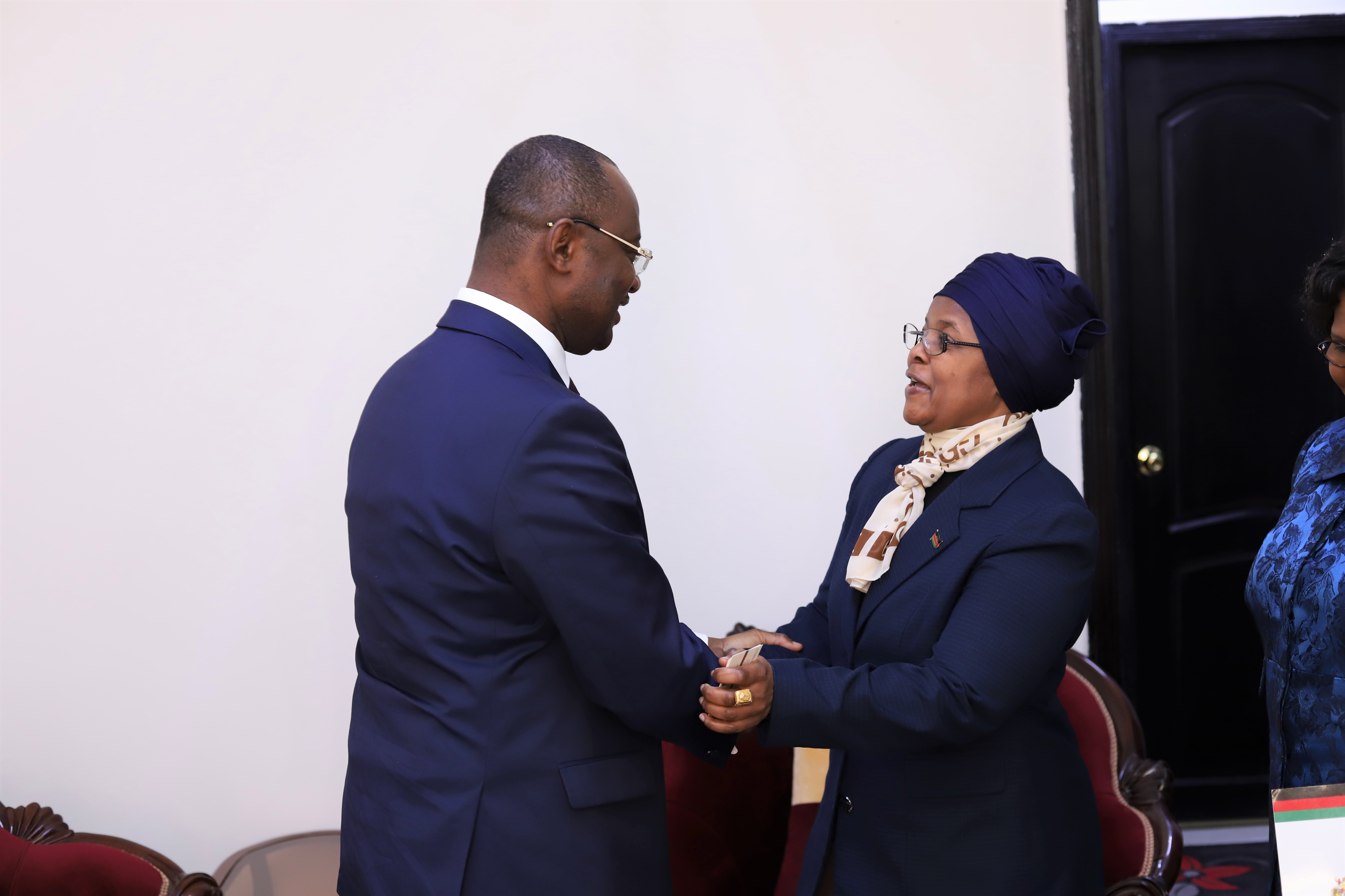 Afreximbank Executive Vice President Dr George Elombi (left) being welcomed by Caroline Bwanali-Mussa, Ambassador of Malawi to Egypt.