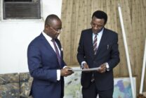 Afreximbank Dr. George Elombi (left) presents document conveying the Bank's donations to Chris Mapanga, Ambassador of Zimbabwe to Egypt