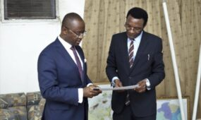 Afreximbank Dr. George Elombi (left) presents document conveying the Bank's donations to Chris Mapanga, Ambassador of Zimbabwe to Egypt