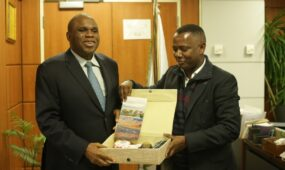 Afreximbank President Prof Benedit Oramah (L) receives gift from Olavo Avelino Garcia Correia Vice Prime Minister and Minister of Finance of Cape Verde.
