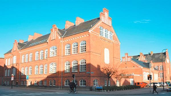 Kingo skaber plads til luksuslejligheder i gamle skolebygninger