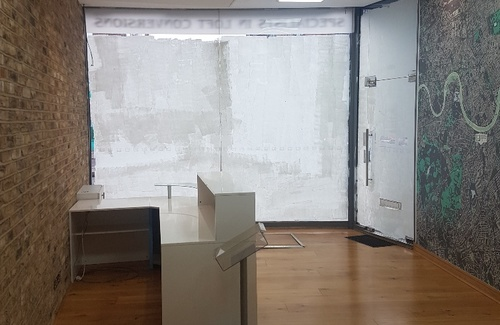 Front office screeded shop front