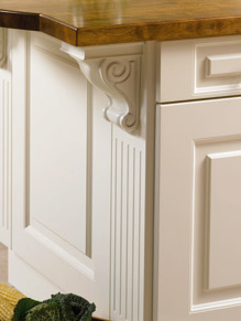 Close up of Beaded Prague kitchen doors in Hornschurch Ivory