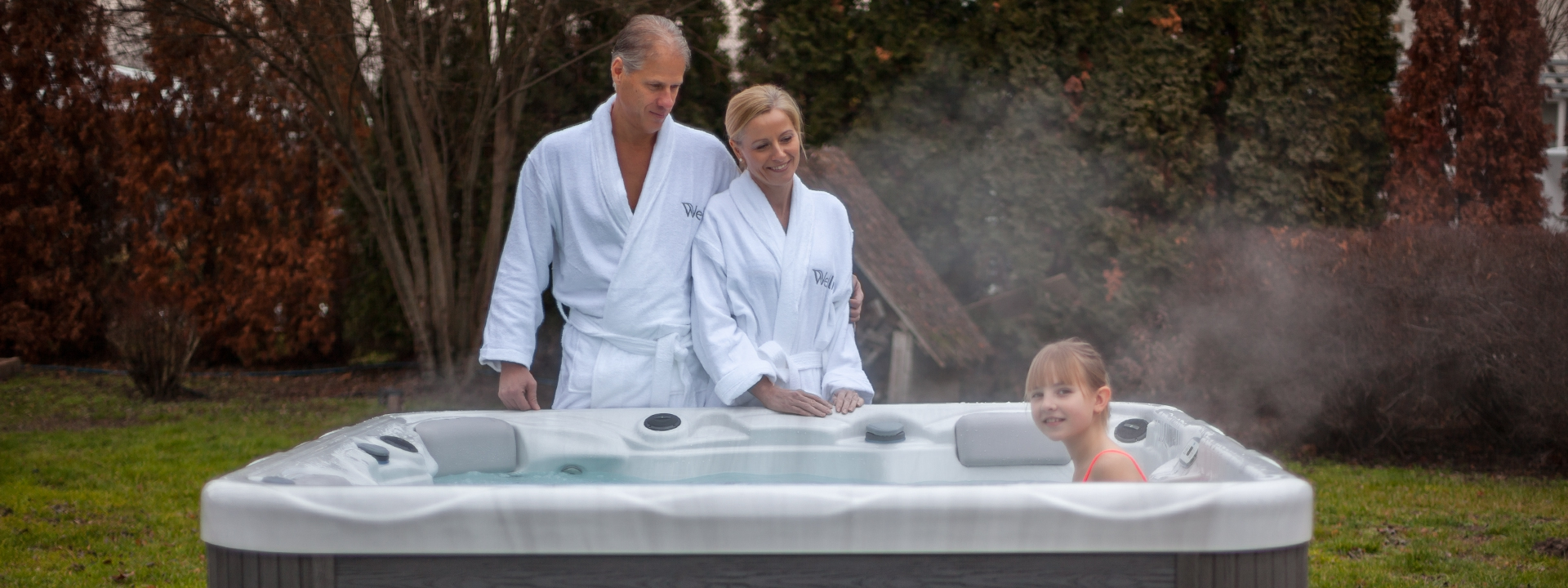 Family using a hot tub